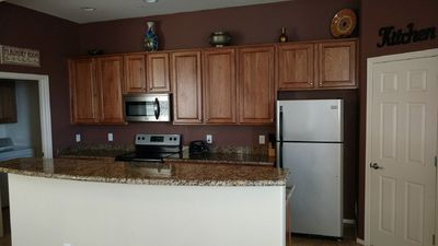 Photo for Gated open concept condo.Minutes from Spring Training,pool,gym, library,tennis