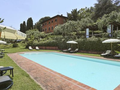 Photo for Beautiful property with pool between olive trees on Lucca hills