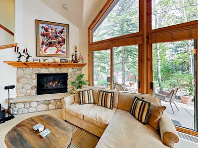 Living Room - Welcome to Edwards! Your rental is professionally managed by TurnKey Vacation Rentals. Snuggle up next to the gas fireplace on a comfy sofa and armchair.