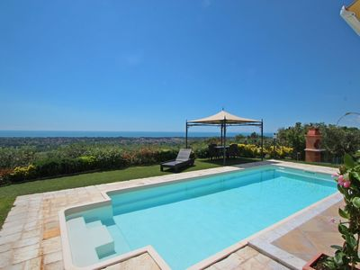 Photo for Stunning private villa with WIFI, A/C, hot tub, private pool, TV, terrace, close to Forte Dei Marmi