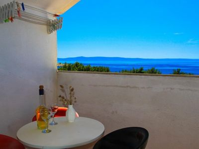 Photo for Two bedroom apartment with balcony and sea view Makarska (A-15200-d)