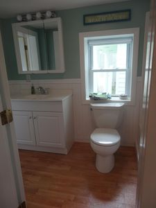 Convenient bathroom is right off of the sun-room and kitchen.