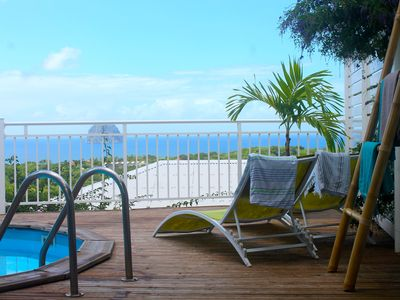 Photo for A Cozy Villa with Outstanding Caribbean Sea Views and Private Pool
