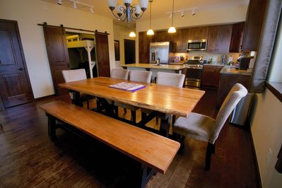 Comfortably seats eight at the live edge farmhouse table