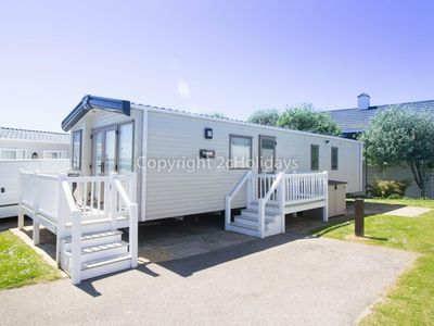 Photo for Haven Hopton platinum caravan for hire with a part sea view & decking ref 80021