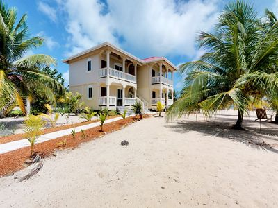 Photo for Enchanting beachfront suite with tropical vibe and sweeping views