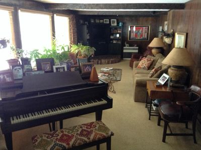 Familyroom with baby grand piano
