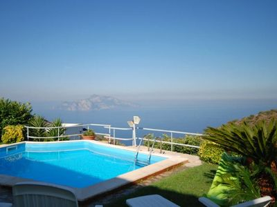 Photo for 9 bedroom Villa, sleeps 17 with Pool, FREE WiFi and Walk to Shops