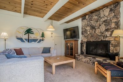 The living room has seating for everyone, an HDTV, DVD player, and wood-burning fireplace