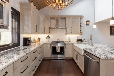 beautifully renovated kitchen with all stainless steel appliances and gas range