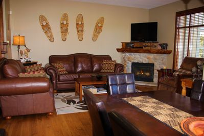 Comfortable living room with plenty of windows, great views and gas fireplace