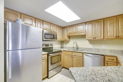 Updated, Fully Equipped Kitchen with Stainless Appliances and Granite Counter Tops