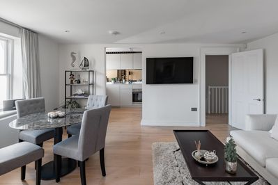 beautiful open plan living room, leading into kitchen