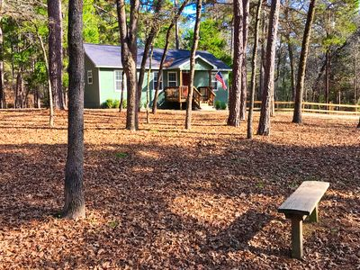 The property is a combination of cleared underbrush and heavily wooded.