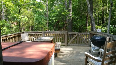 oversized deck overlooking hill with swing