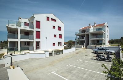 Photo for New and modern apartment with 2 bedrooms, air conditioning, WiFi, parking and a large balcony