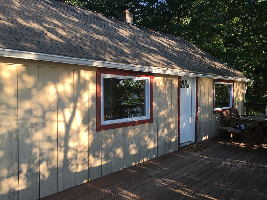 The setting sun casts intricate shadows on the cottage.