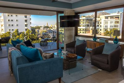Come enjoy this stylish condo with views of the city and the bay.