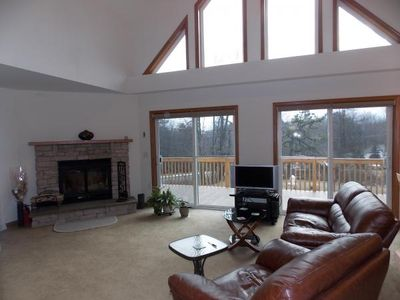 Living Room with Fireplace and Cathedral Ceiling