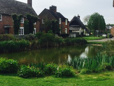 The village clusters round a duckpond. The cottage is 50 yards up the street