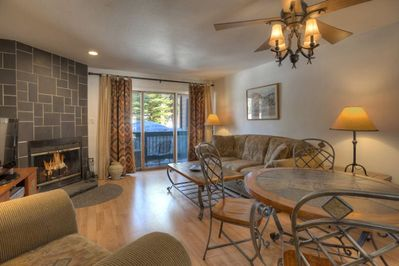 Living room w fireplace and mountain views at Durango Colorado vacation rental home at Silverpick Condominiums