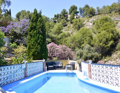 Photo for Beautiful villa near Oliva with private pool, sun terrace and sea views