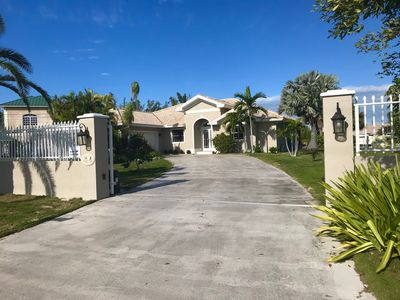 Beautiful Canal Front Gated Property With Pool...Includes Boat & Jeep Wrangler!!