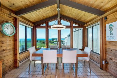 Dining Area - Wall-to-wall windows in the dining area provide incredible views of the bay.