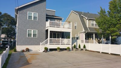 Photo for Pristine Beach Home with large decks, plenty of parking, Close to Everything !!