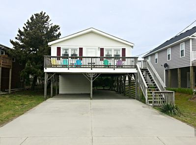 Front of house with large sun deck. Great place to relax after the beach.