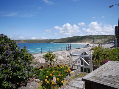 Photo for Well appointed apartment overlooking the sea in Sennen cove