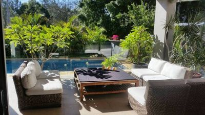 Covered Alfresco area, great for relaxing  overlooking pool.
