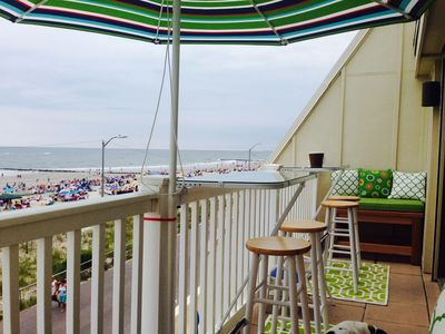 Relax and enjoy the private balcony overlooking the beach and promenade