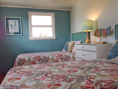 Second bedroom features playful decor & twin beds with Tempur-Comfort mattresses