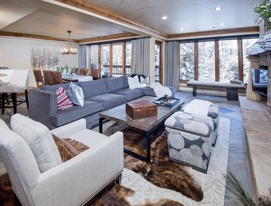 Living Area with sectional sofa.  Views from wall to wall windows