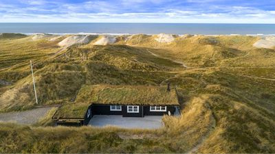 Photo for Unobtrusive holiday home with sea views in a wonderful dune location for 4 persons