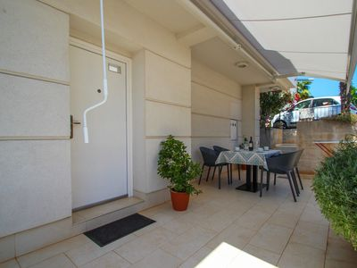 Photo for Holiday apartment with air conditioning and terrace with garden furniture