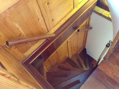 Feature wooden staircase viewed from 1st floor