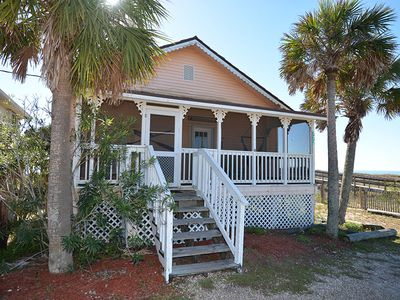 Photo for QUINTESSENTIAL BEACH COTTAGE is three bedrooms, two and a half baths of OLD FLORIDA at its finest