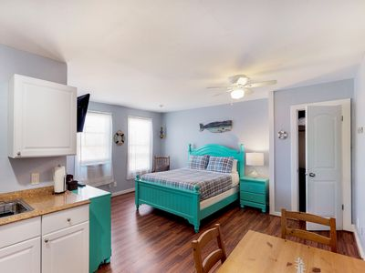 Photo for NEW LISTING! Charming, colorful condo steps from the Seawall - dog are welcome