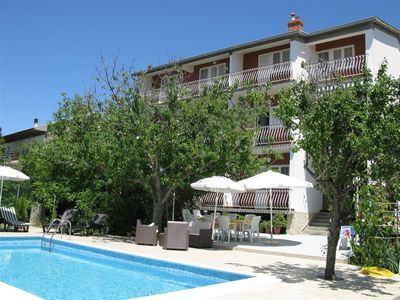 Photo for Holiday apartment with outdoor pool and air conditioning