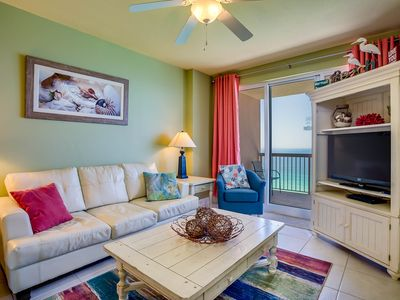 Bright and relaxing living room that opens directly onto the spacious balcony.