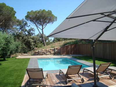 Photo for new villa with heated pool under umbrella pines and olive trees.