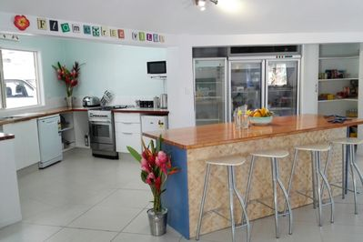 Spacious kitchen area with many appliances