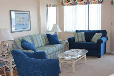 Step through the sliding glass door in living room to the oceanfront balcony.