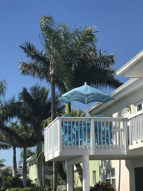 Waterfront Views of Boca Ciega Bay from your Private Balcony. Dolphins & Sunset!