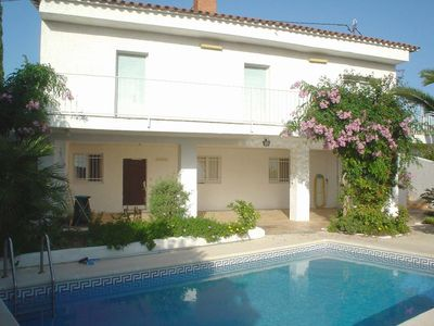 Photo for 5 bedroom Villa, sleeps 8 with Pool, WiFi and Walk to Shops