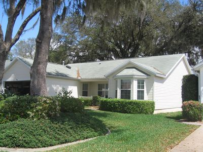 Front of house with live oak trees