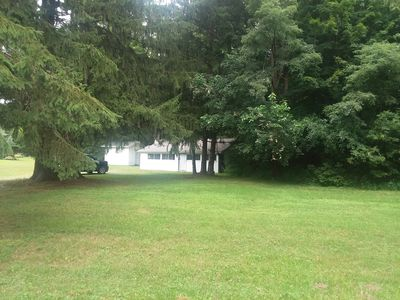 The house sits on a large, private, wooded lot