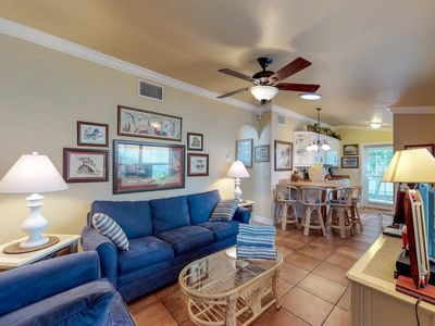 Photo for Charming condo w/ patio, grill & shared pool - 1 block to the beach & trolley!